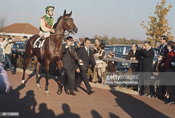 English professional jockey Lester Piggott pictured mounted on the racehorse Nijinsky before competing to win in the 2000 Guineas Stakes on the...