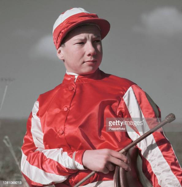 English professional jockey Lester Piggott posed in racing silks on the gallops at Lambourn in Berkshire, England in March 1951.