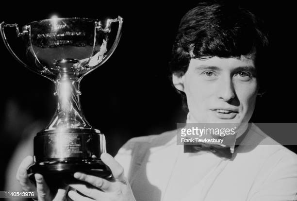 English professional snooker Jimmy White holding his trophy for winning the nonranking snooker tournament 'Benson Hedges Masters' Wembley Conference...