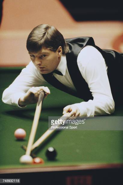 English professional snooker player Dean Reynolds pictured in action during competition in the 1989 Embassy World Snooker Championship at the...