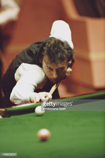 English professional snooker player Jimmy White pictured in action during competition in the 1990 Embassy World Snooker Championship at the Crucible...