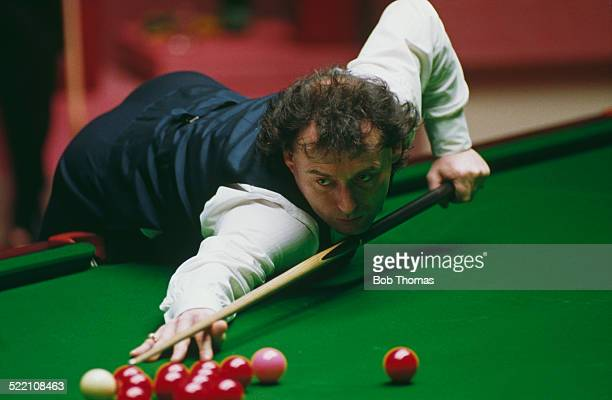 English professional snooker player Jimmy White playing against Stephen Hendry in the final of the Embassy World Snooker Championship at the Crucible...