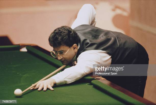 English professional snooker player Joe Johnson pictured in action against Tony Meo in the first round of the 1989 Embassy World Snooker Championship...