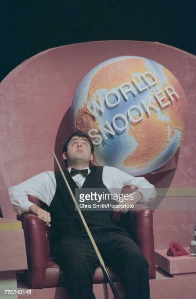 English professional snooker player Ronnie O'Sullivan pictured gazing upwards during competition against fellow English snooker player Peter Ebdon in...