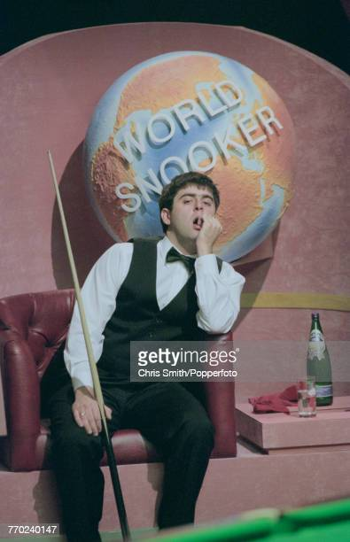 English professional snooker player Ronnie O'Sullivan pictured with a concerned look on his face during competition against fellow English snooker...