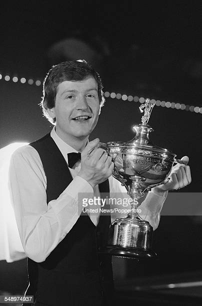 English professional snooker player Steve Davis pictured holding the World Snooker Championship trophy on 4th May 1983