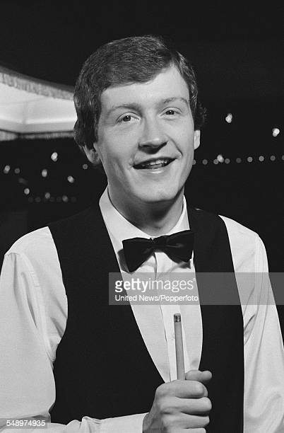 English professional snooker player Steve Davis posed with cue on 4th May 1983
