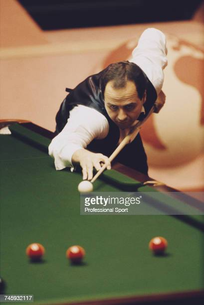English professional snooker player Tony Meo pictured in action during competition in the 1989 Embassy World Snooker Championship at the Crucible...