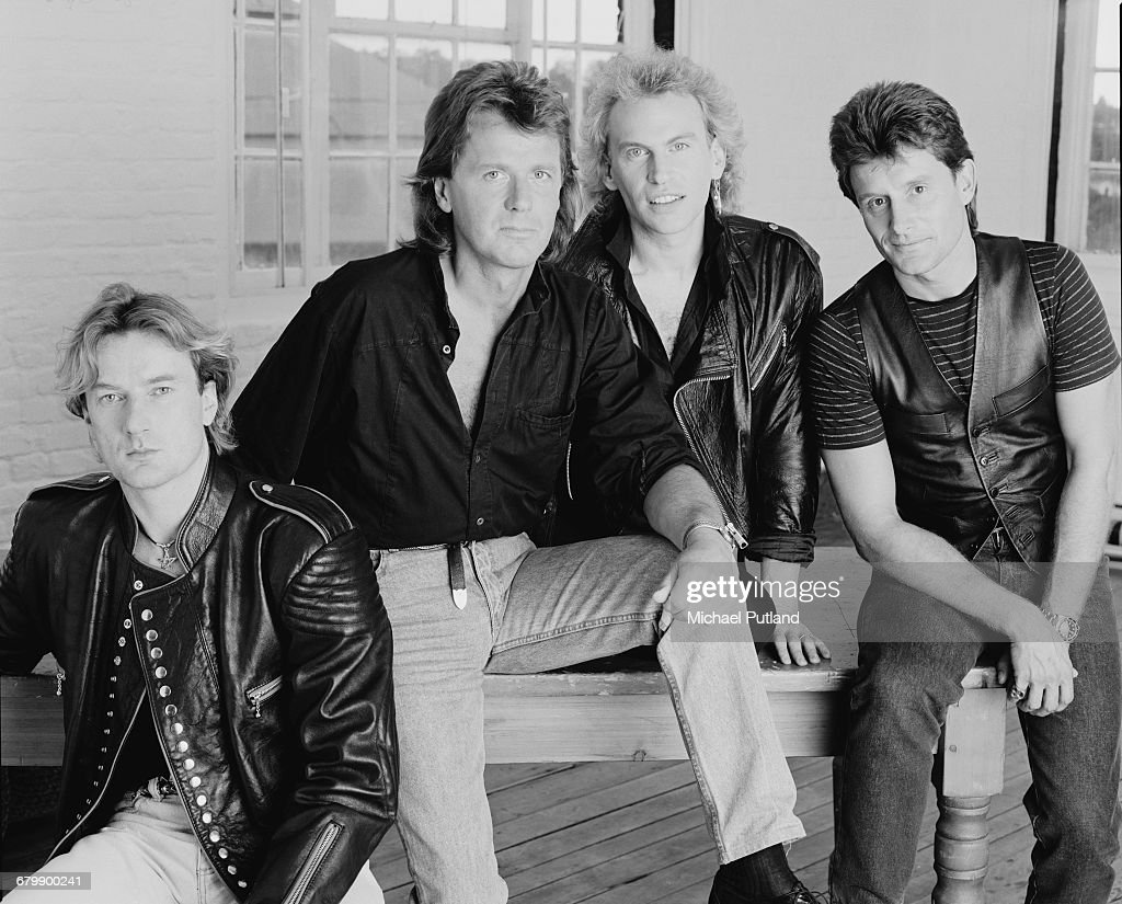 English progressive rock band Asia, London 1990. Left to right: keyboard player Geoff Downes, bassist John Wetton (1949 - 2017), guitarist Pat Thrall and drummer Carl Palmer.