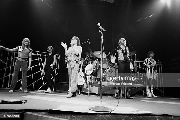 English progressive rock band Yes performing at Madison Square Garden New York 5th August 1977 Left to right guitarist Steve Howe keyboard player...