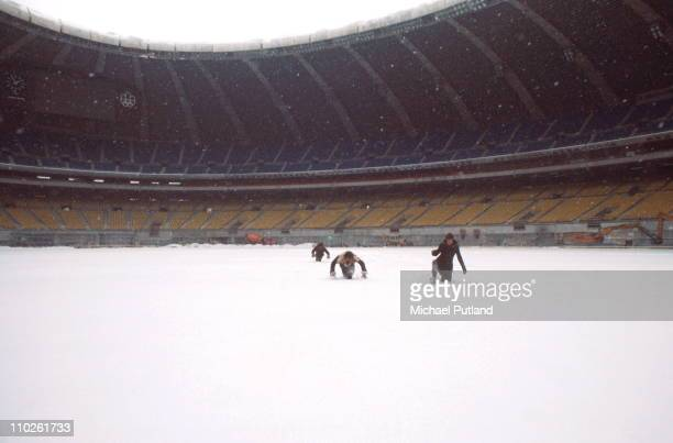 English progressive rock group Emerson Lake And Palmer in the snow during rehearsals for the band's 'Works' tour, at the Olympic Stadium, Montreal,...