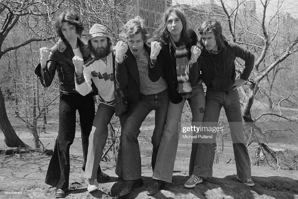 English progressive rock group Genesis in Central Park, New York City, 20th April 1976. Left to right: guitarist Steve Hackett, singer Phil Collins, drummer Bill Bruford, bassist Mike Rutherford and keyboard player Tony Banks.