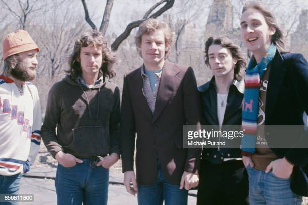 English progressive rock group Genesis in Central Park New York City 20th April 1976 From left to right singer Phil Collins keyboard player Tony...