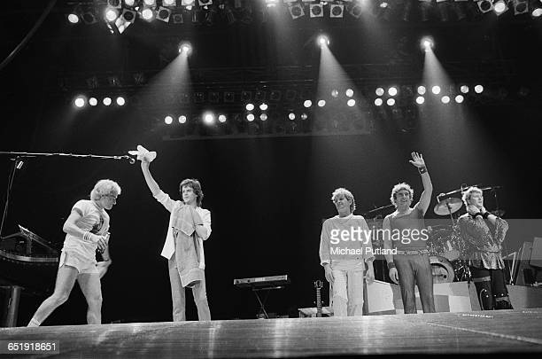 English progressive rock group Yes on stage Florida USA 1984 Left to right drummer Alan White guitarist Trevor Rabin singer Jon Anderson keyboard...