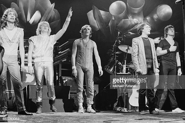 English progressive rock group Yes on stage in November 1980 Left to right Steve Howe Geoff Downes Trevor Horn Alan White and Chris Squire