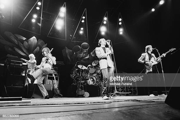 English progressive rock group Yes performing on stage November 1980 Left to right Geoff Downes Steve Howe Trevor Horn and Chris Squire