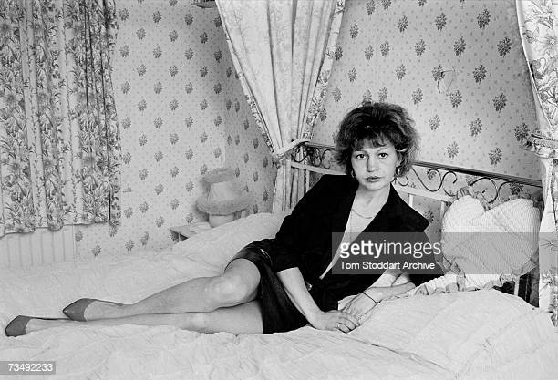English prostitute Monica Coghlan on her four poster bed in her bedroom at home in Rochdale, Lancashire, January 1987. Coghlan was at the centre of a...