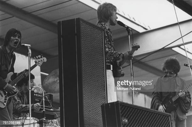 English psychedelic pop group Blossom Toes performing on stage circa 1968 Left to right Brian Belshaw Kevin Westlake Brian Godding and Jim Cregan