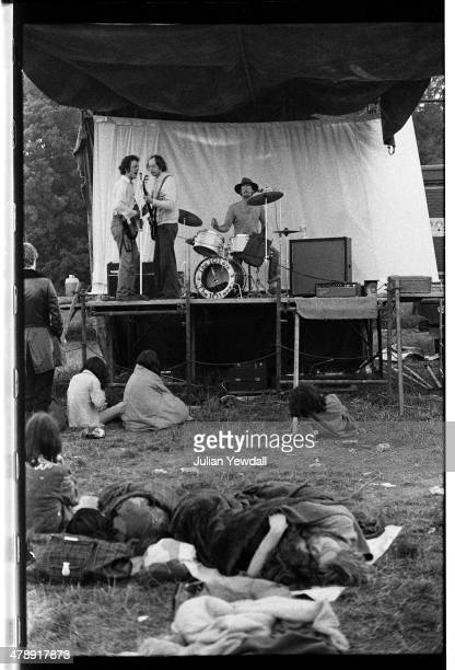 English pub rock group The 101ers performing in the early morning at the Stonehenge Free Festival, 21st June 1975. Left to right: Joe Strummer ,...