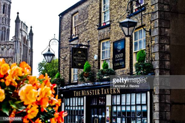 english pub with ely cathedral in the background - bavosi stock pictures, royalty-free photos & images