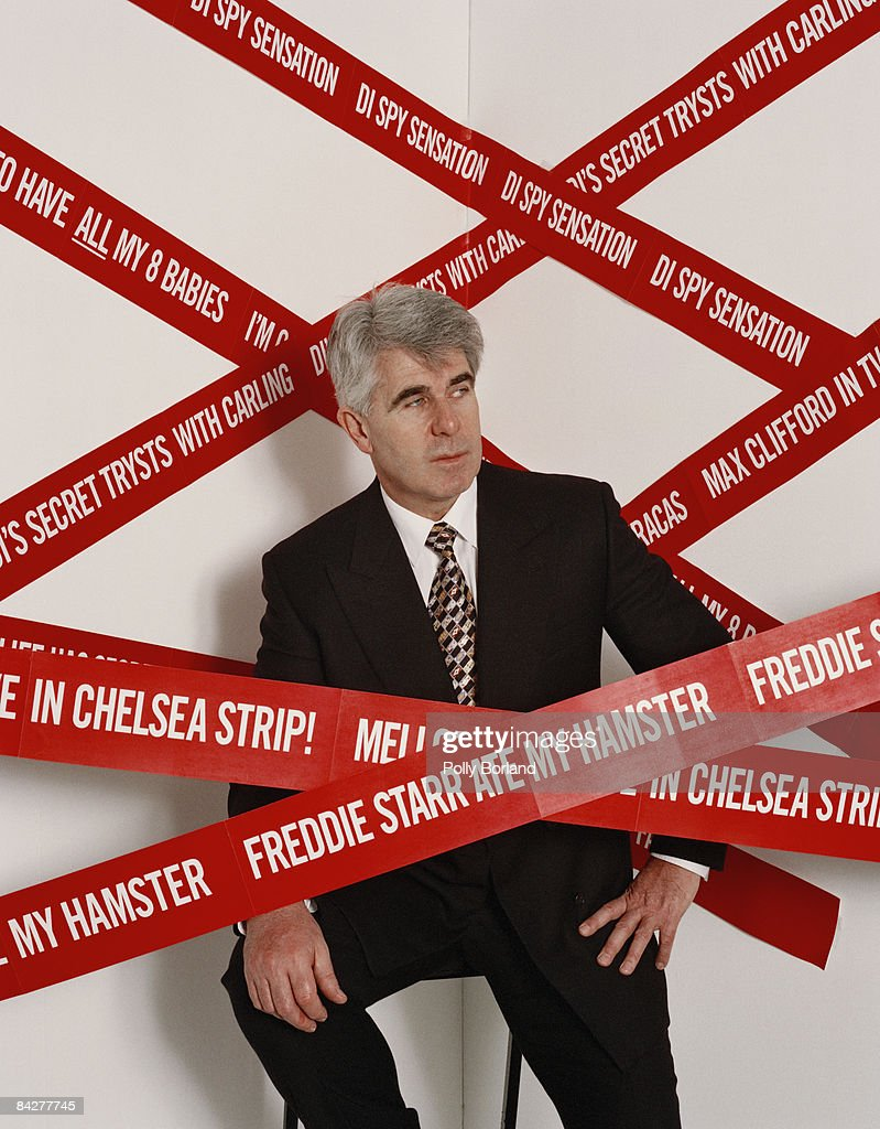 English publicist Max Clifford with some of the more memorable headlines generated by his activities, circa 2000.