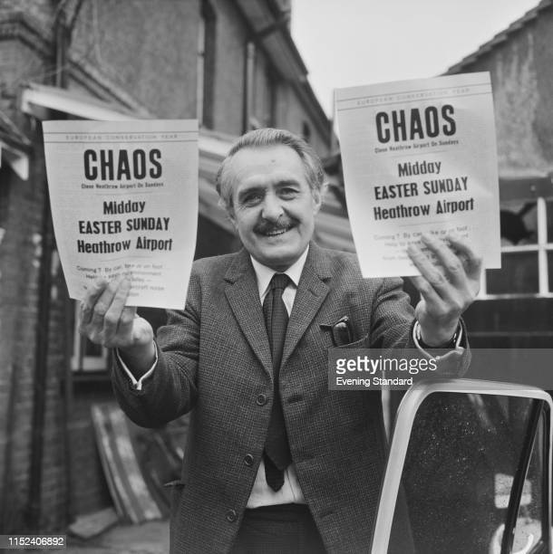 English publisher author and bookseller Gordon Landsborough holding a flyer from protester group 'CHAOS' UK 26th March 1970