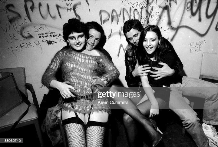 English punk band Sham 69 with two female fans, 4th November 1977.