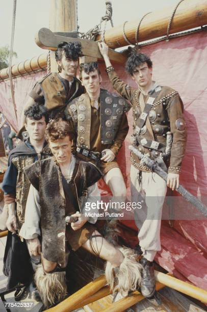 English punk band Tenpole Tudor in a shoot for the video for their single 'Wunderbar' in England in 1981 Clockwise from bottom left guitarist Munch...
