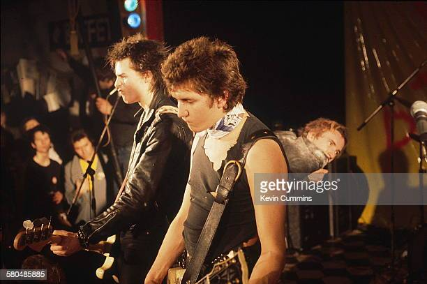 English punk band the Sex Pistols performing at Ivanhoe's Huddersfield on Christmas day 1977 Left to right bassist Sid Vicious guitarist Steve Jones...