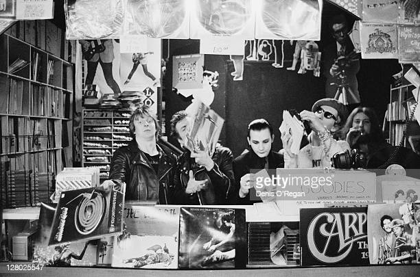 English punk group The Damned in a record shop circa 1978 Left to right drummer Rat Scabies guitarist Brian James singer Dave Vanian and bassist...