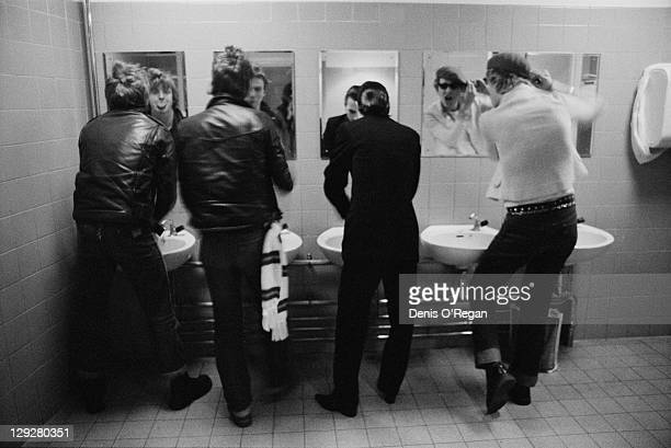 English punk group The Damned in the toilets at the Fairfield Hall Croydon London circa 1978 Left to right drummer Rat Scabies bassist Algy Ward...
