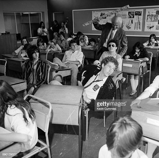 English punk rock group Ed Banger and The Nosebleeds in a classroom during a cover shoot for their single 'Ain't Bin To No Music School' 1977 Left to...