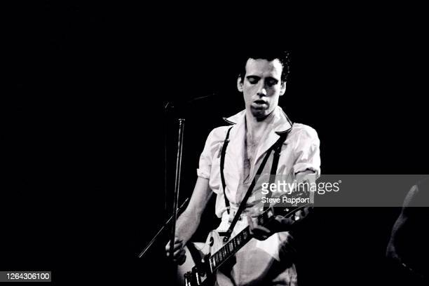 English Punk Rock musician Mick Jones, of the group the Clash, performs at the Lyceum, London, .