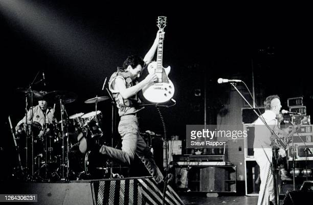 English Punk Rock musicians, from left, Topper Headon , Mick Hones, and Joe Strummer, all of the group the Clash, perform at the Brixton Fair Deal ,...