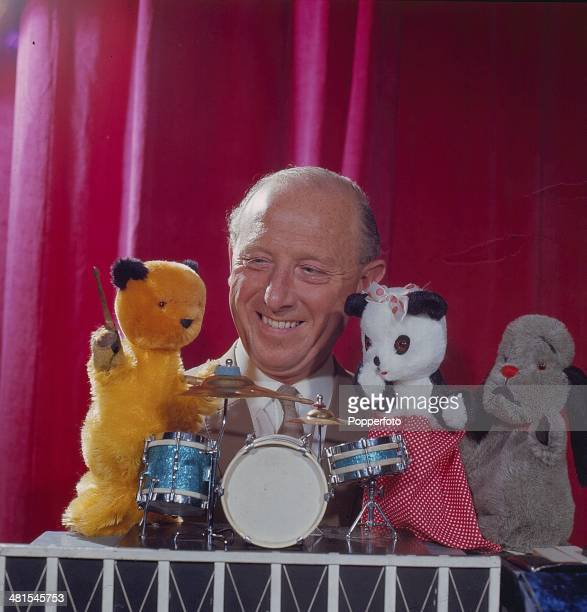 English puppeteer Harry Corbett performs with his puppets Sooty, Sweep and Soo in 1968.