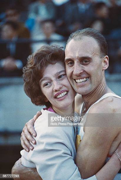 English race walker Ken Matthews celebrates with an unidentified woman after winning the 20km walk event and the gold medal at the 1964 Summer...