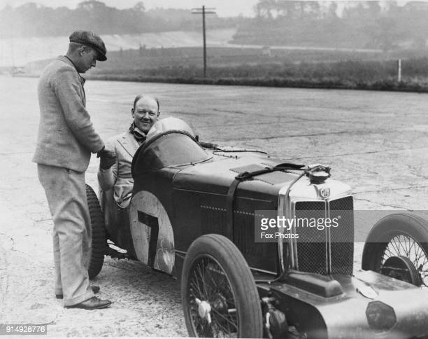 Midget stock photos and pictures getty images english racing driver edward ramsden hall being congratulated after breaking the records for the standing mile publicscrutiny Choice Image