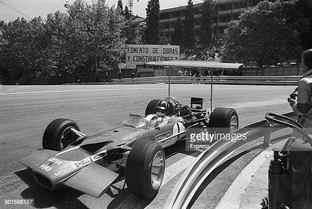 English racing driver Graham Hill driving a Lotus-Cosworth 49B during the Spanish Grand Prix at Montjuich Park in Barcelona, Spain, 4th May 1969....