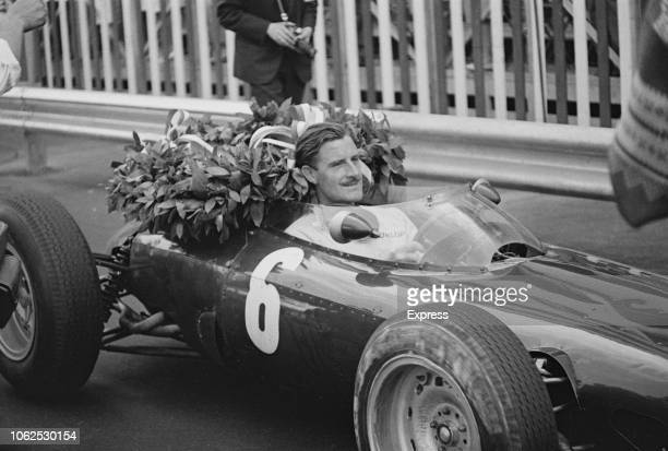 English racing driver Graham Hill pictured in the driver's seat of the Owen Racing Organisation BRM P57 BRM P56 1.5 V8 racing car after finishing in...