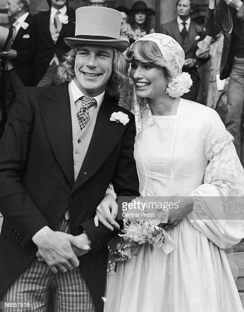 English racing driver James Hunt with Suzy Miller after their wedding at Brompton Oratory London 19th October 1974