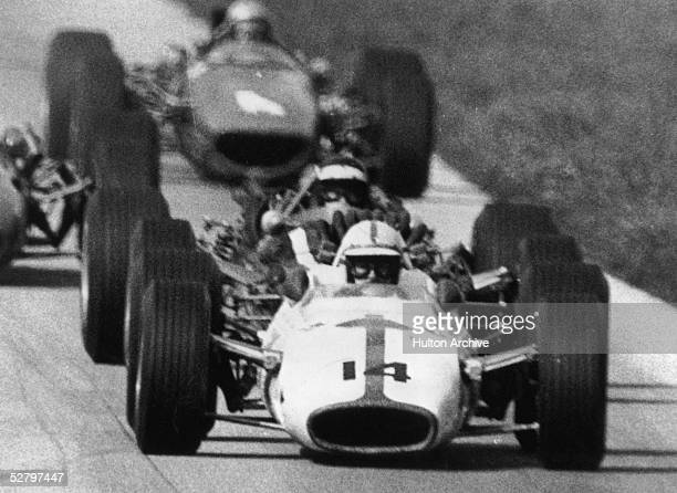 English racing driver John Surtees on his way to victory in the Italian Grand Prix at Monza in a Honda RA300 10th September 1967