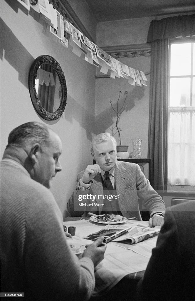 English racing driver Mike Hawthorn (1929 - 1959) at mealtime, Surrey, UK, 5th January 1959.
