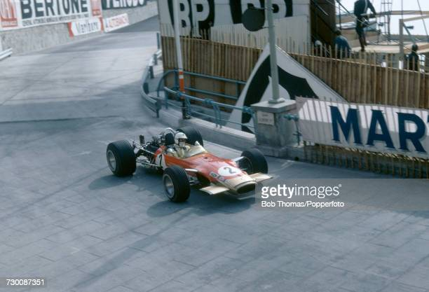 English racing driver Richard Attwood drives the Gold Leaf Team Lotus Lotus 49B Cosworth V8 to finish in 4th place in the 1969 Monaco Grand Prix at...