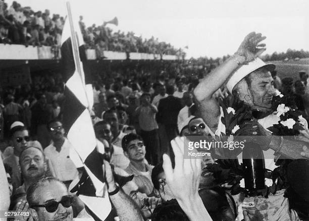 English racing driver Stirling Moss is cheered by the crowd after winning the Argentine Grand Prix in Buenos Aires, 19th January 1958.