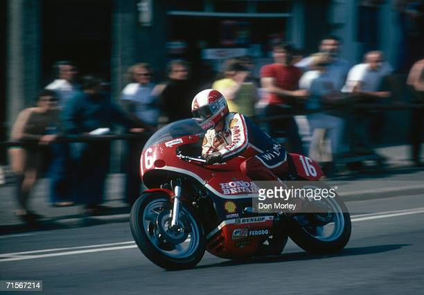 English racing motorcyclist John Williams riding a works Honda down Bray Hill in the Formula One event at the Isle of Man TT races June 1978 Williams...