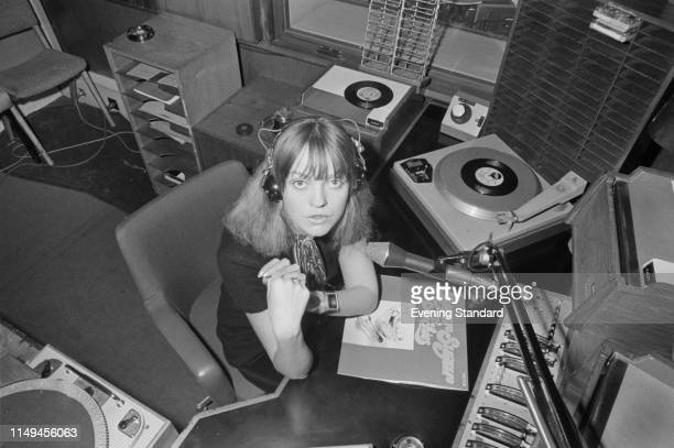 English radio and television broadcaster and disc jockey Annie Nightingale with record 'Sugar Sugar' by the Archies in a radio recording studio UK...