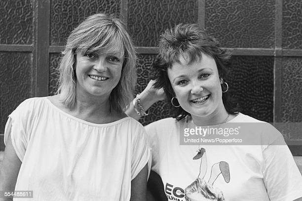 English radio and television broadcasters Annie Nightingale and Janice Long posed together at a press event to launch the BBC television 'Rock Around...