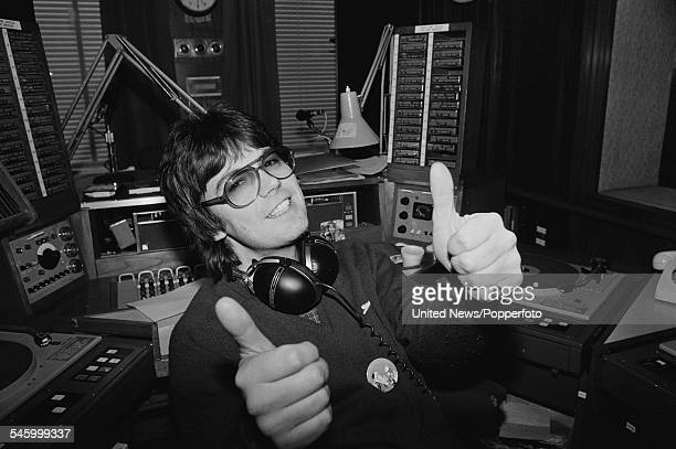 English radio DJ and host of BBC Radio 1 Breakfast show Mike Read pictured in a BBC Broadcasting studio in London on 23rd December 1982