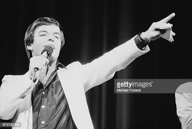 English radio dj Tony Blackburn presenting 'Heroes and Villains', the BBC Radio 1 15th birthday concert, recorded at the Odeon, Hammersmith, London,...
