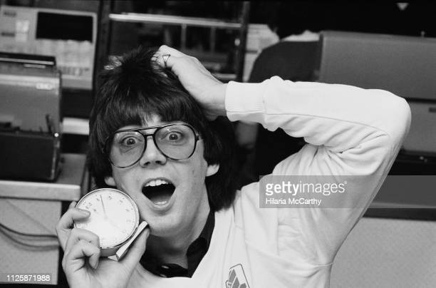 English radio DJ writer journalist and television presenter Mike Read with an alarm clock UK 20th November 1980